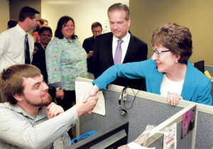 U.S. Sen. Susan Collins greets Barclaycard employee Ben Tucker on Tuesday during a tour of the renovated call center in Wilton. Next to Collins is CEO Curt Hess.