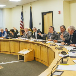 The six Republicans and six Democrats on the Government Oversight Committee vote unanimously Wednesday for an inquiry into Gov. Paul LePage's threat to withhold state funding from a school in the process of hiring House Speaker Mark Eves.