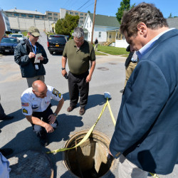 New York Gov. Andrew Cuomo's office shows Cuomo, right, with Steven Racette, center, superintendent of Clinton Correctional Facility, looking at a manhole in Dannemora, N.Y., on June 6, before Racette was placed on administrative leave. A pair of inmates escaped through a manhole.