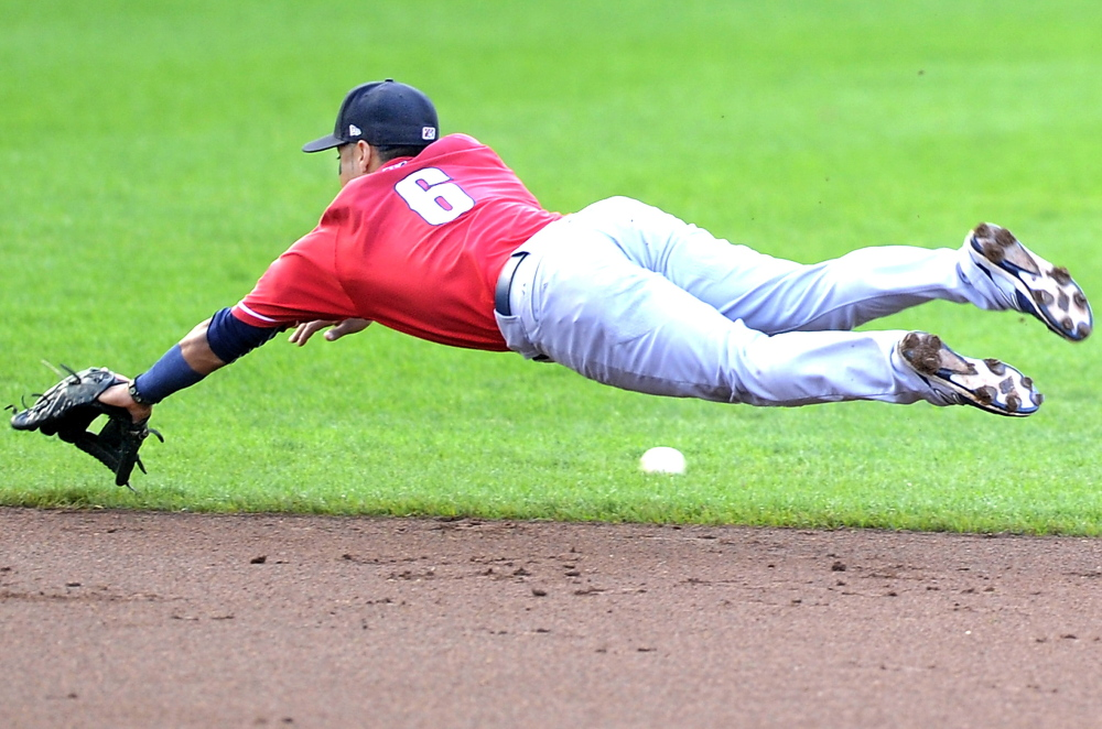 Jorge Florez of the New Hampshire Fisher Cats gives an all-out effort but the ball eludes him for a single Wednesday night at Hadlock Field. The Portland Sea Dogs collected seven hits but couldn't score in yet another frustrating loss, 2-0.