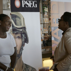Sophia Lewis, left, with PSEG Long Island, speaks to an attendee about employment opportunities during a job fair at Citi Field in New York this week.