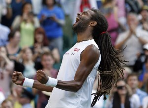 Dustin Brown of Germany celebrates after defeating Rafael Nadal of Spain in their singles match at the All England Lawn Tennis Championships in Wimbledon, London, on Thursday.