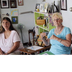 Brenda Beaulieu, left, of Fairfield listens as Jan Strout of West Gardiner speaks during a recent Augusta Area Kinship Support group meeting. Lacking state support and often financially strapped, Maine grandparents raising their grandchildren have been selling baked goods and holding yard sales to help each other out.