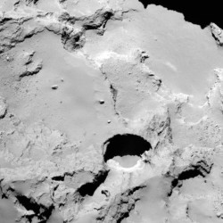 Photo made by the European Space Agency's Rosetta spacecraft shows one of numerous sinkholes on comet 67P.