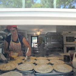 Shari Hamilton, owner of Hello Good Pie Co. Bakery, prepares a batch of pies for baking Thursday in Belgrade.