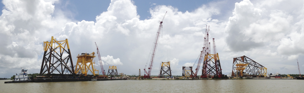 Structural components for Deepwater Wind are loaded onto barges in Houma, La., last week. The first barge is expected to arrive at Block Island, R.I., by mid-July, allowing workers to begin installing the massive foundations for the five-turbine, 30-megawatt facility.