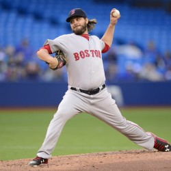 Boston Red Sox starting pitcher Wade Miley throws against the Toronto Blue Jays during the first inning of a baseball game, Thursday, July 2, 2015, 2015 in Toronto.  (Frank Gunn/The Canadian Press via AP)