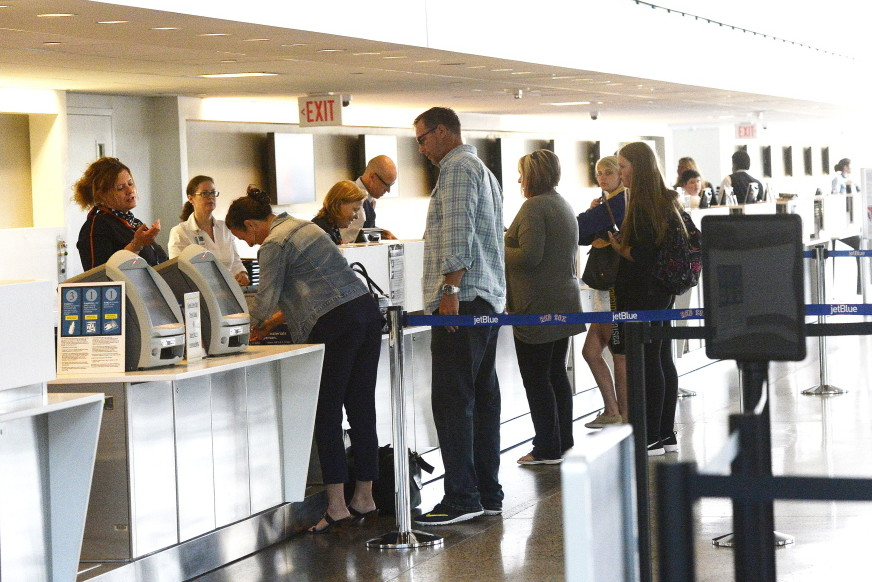 Passengers get tickets and check luggage Thursday at the Portland International Jetport. Snowstorms reduced the jetport's passenger counts in February through March, but the arrival of good weather turned the trend around in May, which brought a 2.4 percent increase.