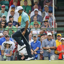 Tiger Woods reacts to a missed par putt on the 17th hole Thursday during the first round of the Greenbrier Classic golf tournament in West Virginia. Woods bogied the hole but still finished with a 66, four shots behind the leader, Scott Langley.