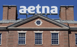 A sign for Aetna Inc., sits atop a building at the company headquarters in Hartford, Conn. Health insurer Aetna Inc. has made a deal to buy competitor Humana Inc. in a $37 billion deal the companies say would create the second-largest managed care company.