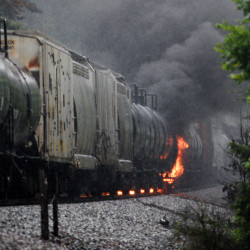 Smoke and flames rise after the derailment of a CSX train car Thursday in Maryville, Tenn. The train was carrying flammable and toxic material.
