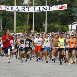 It was crowded at the starting line for the 39th annual Bridgton 4 on the Fourth on Saturday morning in Bridgton, where exactly 2,000 runners, many sporting red, white and blue, finished the 4-mile road race.