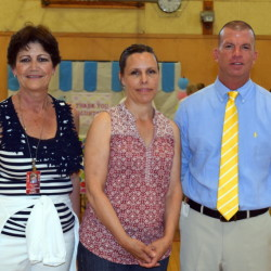 Marcia Ciorra, center, the Wells-Ogunquit school district's Exemplary Volunteer of the Year, joins Maryanne Foley, left, community resource coordinator, and Interim Superintendent Jim Daly at the ice cream social honoring school volunteers.