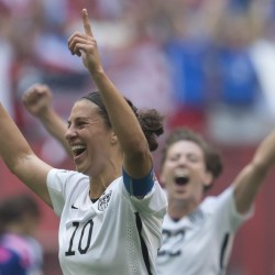 Carli Lloyd of the United States, left, celebrates her goal with Meghan Klingenberg in Sunday's Women's World Cup soccer championship against Japan in Vancouver, British Columbia. Jonathan Hayward/The Canadian Press via AP