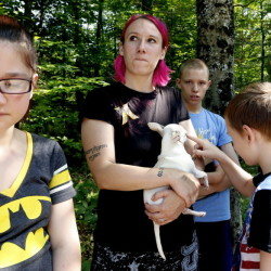 Jeanine Lent, center, who lives with her family on Bonny Eagle Road in Standish, was handcuffed for 45 minutes, along with her mother and husband Sunday. Derek Davis/Staff Photographer