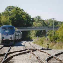 An Amtrak Downeaster train sits on the tracks near the Brunswick station. In June, trains were arriving in Brunswick three hours late. Now it's usually 30 minutes to an hour.