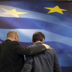 New Greek Finance Minister Euclid Tsakalotos, right, and outgoing Finance Minister Yanis Varoufakis leave together after a hand-over ceremony in Athens, on Monday. Greece is facing potential ejection from the eurozone.