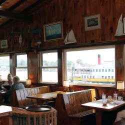 "A Casco Bay Line ferry sits outside Cook's Lobster House in Harpswell. Jen Charboneau, the new co-owner of the restaurant, plans to ""make what's there a little bit better."""