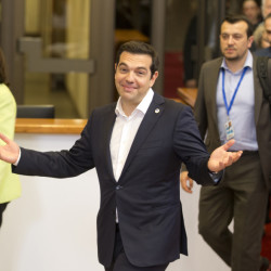 Greek Prime Minister Alexis Tsipras, center, leaves after an emergency meeting of eurozone heads of state or government in Brussels on Tuesday. The eurozone leaders gave Tsipras a Sunday deadline to come up with a viable proposal to save his country from financial ruin.