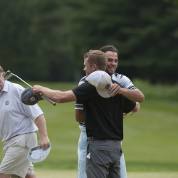 John Hayes IV, center, tips his hat to Mark Plummer as he is embraced by his caddie, Alex McFarlane, on the 18th hole of the Waterville Country Club. Hayes won the Maine Amateur title with a three-day score of 201, nine under par. Kevin Bennett photo