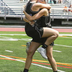 In her final high school game, Lindsey Poirier, right, finished in style with a Class A girls' lacrosse state championship, which she celebrated with Gabrielle Bazemore and the rest of her Marshwood teammates.