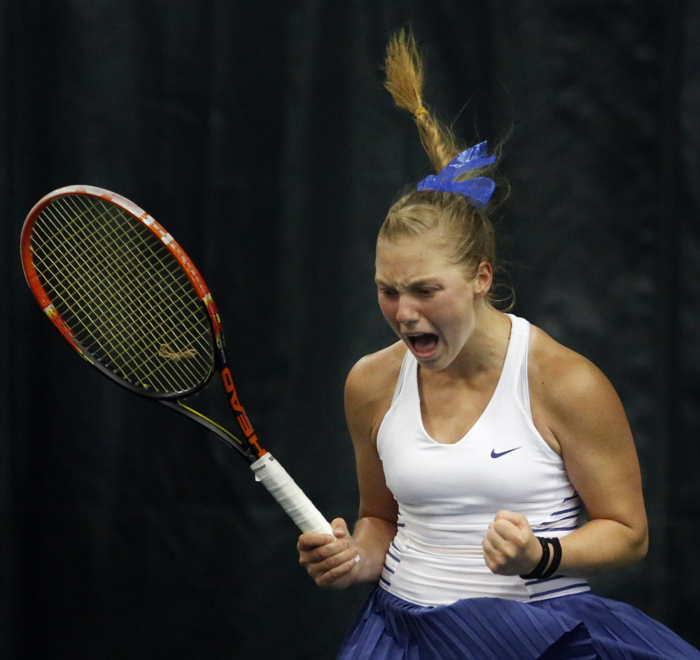 Olivia Leavitt of Falmouth celebrates after winning her third straight singles state championship in June. Then two weeks later, she helped Falmouth win its eighth straight team state championship.