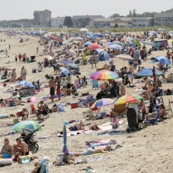 """Beachgoers crowd Old Orchard Beach on Friday. Canada is typically the second- or third-most important market for Maine tourism. """"In 2009 they saved us,""""says Greg Dugal of the Maine Innkeepers Association, speaking of Canadian tourists who had money to spend while the U.S. economy tanked."""