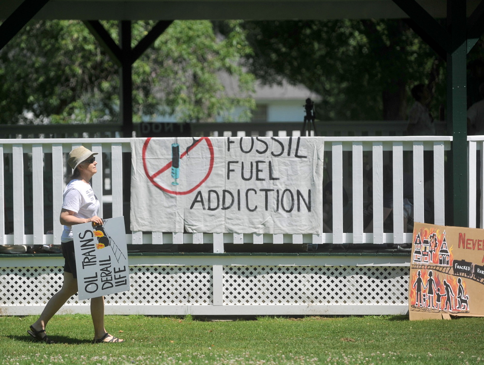 A woman arrives on Saturday at Veteran's Memorial Park in Fairfield for a protest against oil trains.