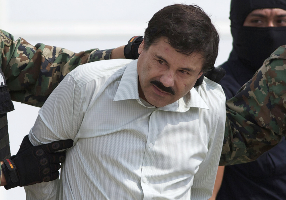 "Joaquin ""El Chapo"" Guzman, head of Mexico's Sinaloa Cartel, is escorted to a helicopter in Mexico City in February 2014 following his capture in the beach resort town of Mazatlan."