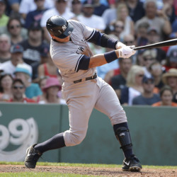 Yankees' Alex Rodriguez lines into a double play on a pitch by Boston's Alexi Ogando in the seventh inning at Fenway Park on Sunday. The Yankees won, 8-6. The Associated Press