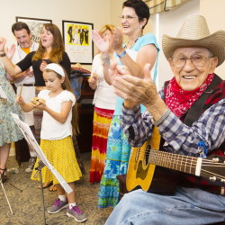 """Paul Farrell claps after singing """"Happy Birthday"""" to a fellow resident at the Avita of Stroudwater assisted living facility in Westbrook, as he and more than a dozen family members provided musical entertainment."""
