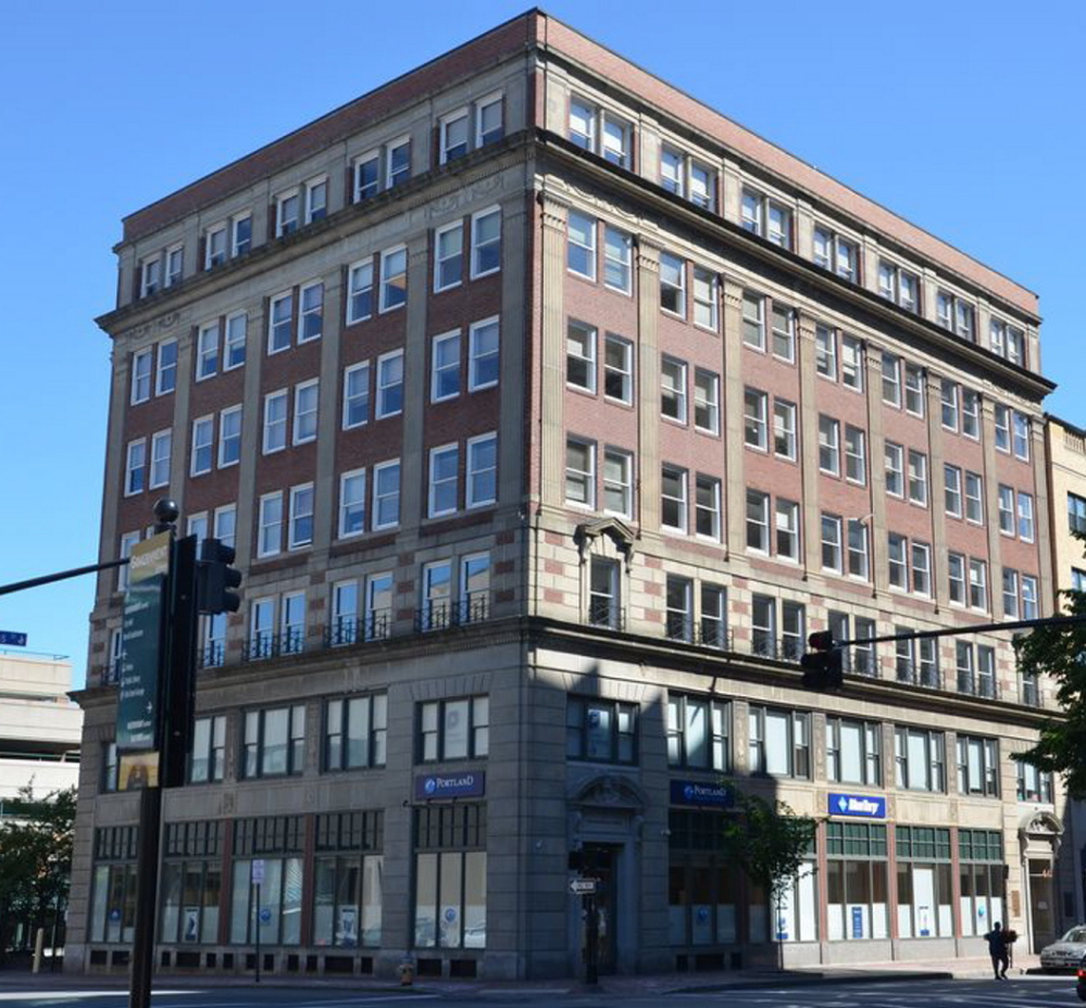 The Clapp Memorial Building at the corner of Congress and Elm streets would house 30 market-rate units. A city development official calls it a 'perfect fit in a perfect location.'