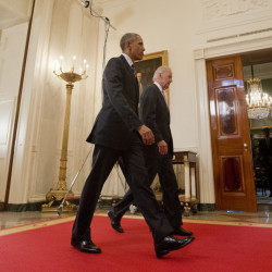 President Barack Obama walks with Vice President Joe Biden after delivering remarks in the East Room of the White House in Washington on Tuesday after an Iran nuclear deal was reached.