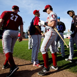 PORTLAND, ME - JULY 15: Dan Gamache of the Altoona Curve, center, takes off his batting gloves after winning the home run derby before the Eastern League All Star game at Hadlock Field Wednesday, July 15, 2015. (Photo by Gabe Souza/Staff Photographer)