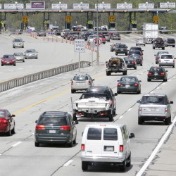 A new toll plaza would be designed to allow motorists to pay cash at booths or to pay electronically by using highway-speed center lanes. Press Herald File Photo/Jill Brady