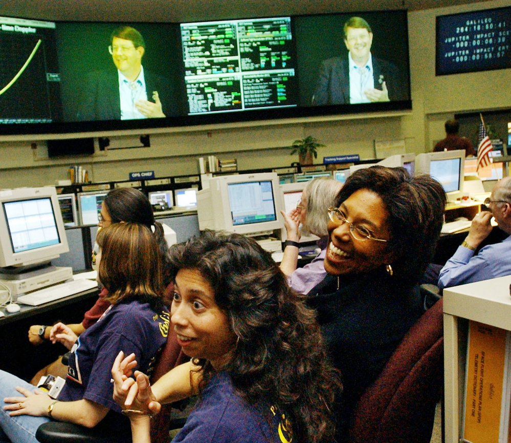 Claudia Alexander, right, project manager for Galileo, works in the mission control room in Pasadena, Calif., along with engineer Nagin Cox, center, and others in 2003.