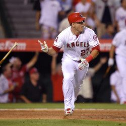 Mike Trout tosses his bat after hitting a home run with two outs in the bottom of the ninth inning Friday to give the Angels a 1-0 win over the Red Sox.