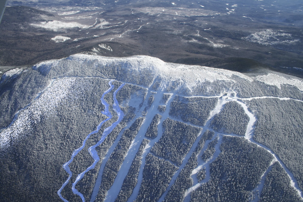 An aerial photo of the summit ski trails at Saddleback Maine ski area.