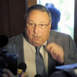 Gov. Paul LePage talks to a reporter about his veto messages as he leaves the State House in Augusta last Thursday.