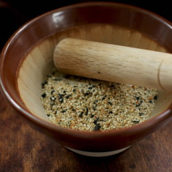 Gomasio is a Japanese dry condiment made from lightly ground sesame seeds and salt. Some variations also include toasted seaweed.  The Associated Press