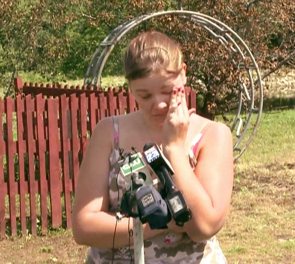 An emotional Brittany Irish talks to the media Wednesday outside her parents' home in the northern Maine town of Benedicta, five days after she was shot and raped by an acquaintance. Photo courtesy WCSH6-TV