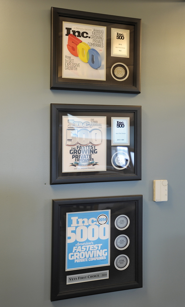 Awards hang on a wall of Vets First Choice offices in Portland.