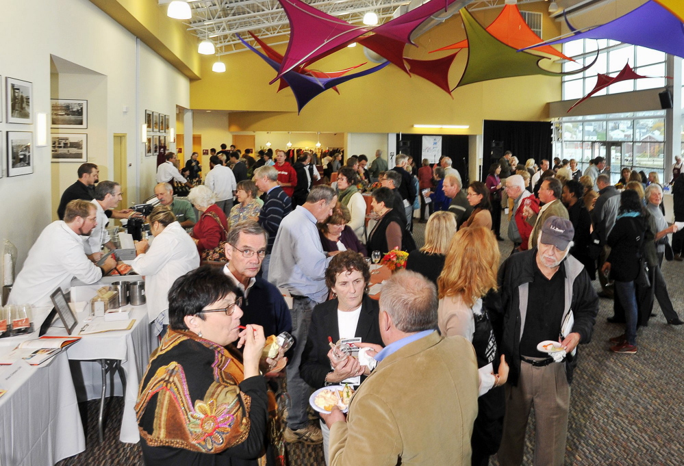Patrons enjoy the food at the 2015 Harvest on the Harbor at Ocean Gateway in Portland.