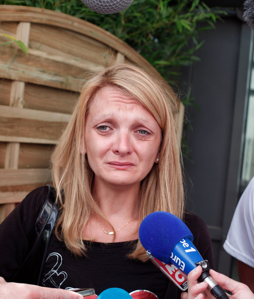 Rachel Lambert speaks in Reims, France, on Thursday about pulling life support for her husband. The Associated Press