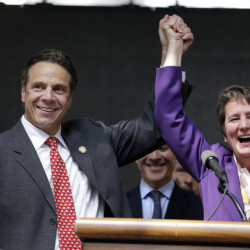 New York Gov. Andrew Cuomo and Service Employees International Union President Mary Kay Henry rally after a state board endorsed a wage hike for fast-food workers.