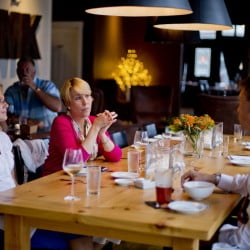 Theresa Hartman, left, and Leslie Finkelstein of Baltimore dine with Joel Shinofield of Norfolk, Va., at MK Kitchen in the center of Gorham.