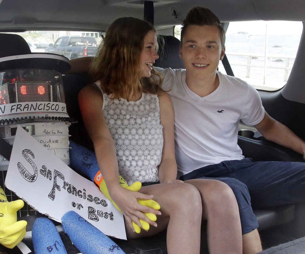 HitchBOT gets a ride July 17 from German tourists in Massachusetts. The Associated Press