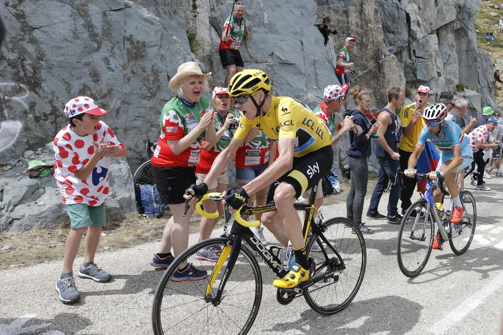 Britain's Chris Froome, wearing the overall leader's yellow jersey, and Italy's Vincenzo Nibali climb during during the 20th stage of the Tour de France on Saturday.
