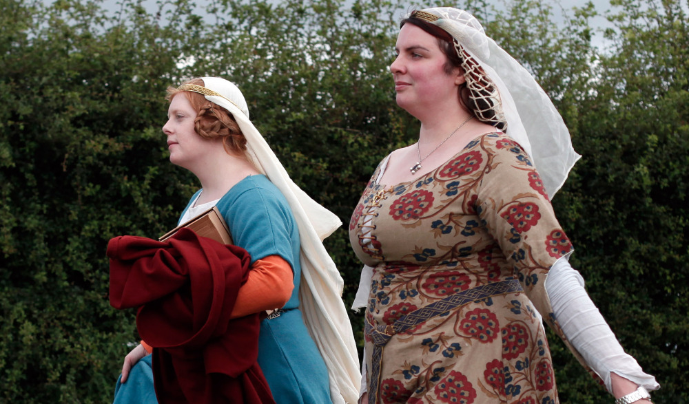 Women wear medieval garb during the re-enactment of the Battle of Agincourt Saturday.