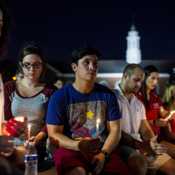 """Students gather during a vigil Friday night for The Grand 16 theater shooting victims at the University of Louisiana at Lafayette. John Russell Houser stood up about 20 minutes into Thursday night's showing of the film """"Trainwreck"""" and fired on the audience with a semi-automatic handgun."""